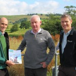 Phil Davies (L), Founding Director of Community Energy Cumbria shows the Share Offer Document to Clive Wickham (R), Partnerships Manager at LDNP and Dave Townley (C), Site Manager for Ellergreen Hydro.